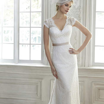 "Redefine romance in this stunning lace sheath dress, complete with illusion lace back and cap-sleeves. Finished with optional detachable grosgrain ribbon belt and pearl button over zipper closure.  <a href=""http://www.maggiesottero.com/dress.aspx?style=5MR102"" target=""_blank"">Maggie Sottero Spring 2015</a>"
