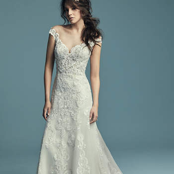 "<a href=""https://www.maggiesottero.com/maggie-sottero/serena/11431"">Maggie Sottero</a>  Embroidered lace motifs cascade over tulle in this romantic illusion off-the-shoulder slim A-line wedding dress, completing the portrait neckline, sheer bodice, and illusion keyhole back. Finished with covered buttons over zipper closure."