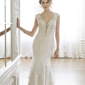 "The perfect blend of sophisticated romance is found in this lace A-Line wedding dress complete with plunging illusion neckline, lace sleeves, and daring keyhole back. Finished with covered button over zipper back closure. Available with front snap-in modesty panel.  <a href=""http://www.maggiesottero.com/dress.aspx?style=5MC036"" target=""_blank"">Maggie Sottero Spring 2015</a>"