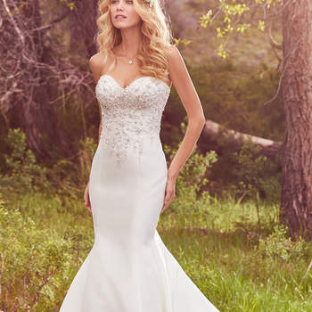 "Pearls, Swarovski crystals, and delicate beading adorn the bodice of this Kada Mikado fit-and-flare, featuring a strapless sweetheart neckline. Finished with covered buttons over zipper and inner corset closure.  <a href=""https://www.maggiesottero.com/maggie-sottero/layton/10119?utm_source=mywedding.com&amp;utm_campaign=spring17&amp;utm_medium=gallery"" target=""_blank"">Maggie Sottero</a>"