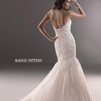 "Beautifully embellished lace adorns this dramatic fit and flare, with a sweetheart neckline and subtle sparkle. Finished with signature corset back closure.  <a href=""http://www.maggiesottero.com/dress.aspx?style=3MS763"" target=""_blank"">Maggie Sottero Platinum 2015</a>"