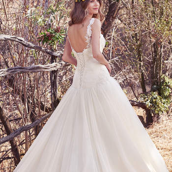 This enchanting ballgown features a ruched bodice and dropped waist. Lace appliqués adorn the bodice, while layers of tulle complete the voluminous skirt. Finished with corset closure. Illusion straps accented in lace appliqués sold separately.