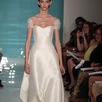 "<a title=""Vestidos de noiva 2013"" href=""https://www.zankyou.pt/p/vestidos-de-noiva-2013"" target=""_blank"">Saiba mais sobre as colecções de vestidos de noiva 2013.</a>"