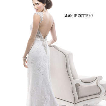 "Dazzle in this sensational sheath dress of beaded Chantilly lace with soft, cording detail and bead embroidered trim, accented with Swarovski crystals. Finished with zipper and crystal button closure.  <a href=""http://www.maggiesottero.com/dress.aspx?style=4MS884"" target=""_blank"">Maggie Sottero Platinum 2015</a>"