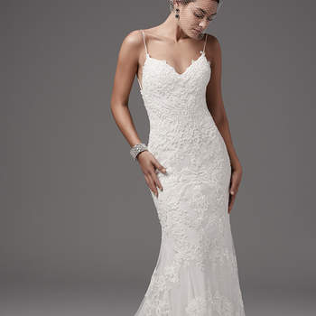 "Chic and alluring, this tulle fit-and-flare features shimmering lace appliqués and bead detailing over Inessa jersey. Gorgeous criss-cross strap details accent the gown's open back, completing the shoulder strap V-neckline. Finished with zipper closure.  <a href=""https://www.maggiesottero.com/sottero-and-midgley/bristol/10210?utm_source=mywedding.com&utm_campaign=spring17&utm_medium=gallery"" target=""_blank"">Sottero and Midgley</a>"
