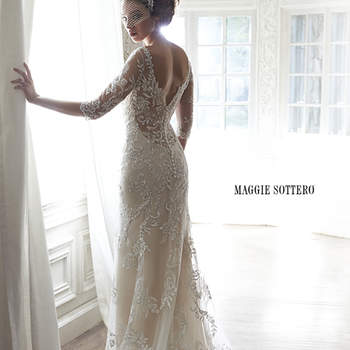 "A dramatic illusion lace back and illusion sleeves adorn this hand-embellished sheath gown, glimmering with metallic lace appliqués and embroidered with Swarovski crystals drifting from shoulder to floor-skimming hem. A delicate scalloped hemline completes the look. Finished with pearl button over zipper back closure.   <a href=""http://www.maggiesottero.com/dress.aspx?style=5MW113"" target=""_blank"">Maggie Sottero Spring 2015</a>"