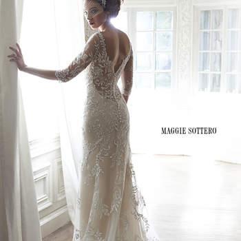 """El encaje en la espalda y las mangas de malla ilusión adornan este vestido de novia con el que brillarás gracias a sus apliques metálicos y sus bordados con cristales Swarovski. ¡Un delicado diseño con el que te sentirás como una princesa!  <a href=""""http://www.maggiesottero.com/dress.aspx?style=5MW113"""" target=""""_blank"""">Maggie Sottero Spring 2015</a>"""