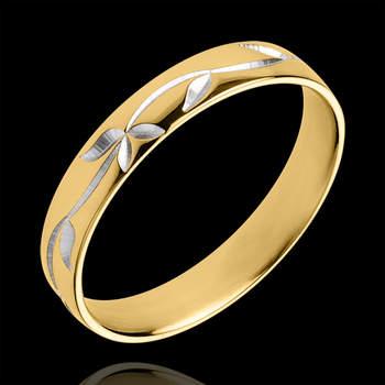 Elegante alianza de oro amarillo grabada con un delicado follaje de oro blanco, ambos de 18 quilates. Foto: Edenly.  http://tinyurl.com/bt8j4am