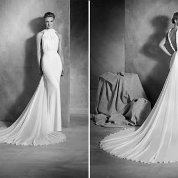 Sofisticado vestido de novia sirena realizado en crepe y gasa seda, con escote halter drapeado y decorado con aplicaciones de pedrería y talle bajo. Un diseño muy femenino que realza la figura aportando delicadeza y mucha clase.