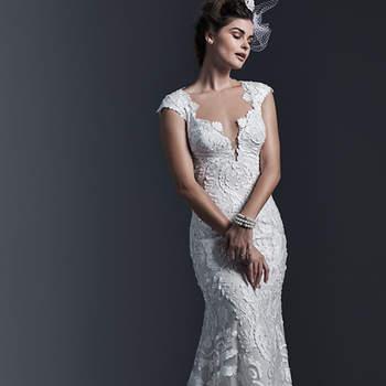 """Vestido de novia con dramáticos cortes laser hechos con encaje. La silueta es ceída para endulzar la figura y también se acompaña de mangas cortas y un escote pronunciado el frente. El cierre es con botones sobre cremallera.    <a href=""""http://www.sotteroandmidgley.com/dress.aspx?style=5ST660"""" target=""""_blank"""">Sottero &amp; Midgley</a>"""
