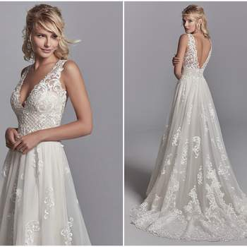 "Lush lace motifs and crosshatching cascade over tulle in this A-line wedding dress, accenting the unique train, nude waistline, V-neck, illusion straps, and illusion V-back. Finished with covered buttons over zipper closure.  <a href=""https://www.maggiesottero.com/sottero-and-midgley/oliver/11221?utm_source=zankyou&amp;utm_medium=gowngallery"" target=""_blank"">Sottero and Midgley</a>"