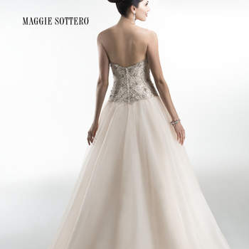 "Stunning Chic organza ballgown accented with exquisite, heavily beaded Swarovski crystal bodice and sweetheart neckline. Crystal buttons adorn a zipper over inner corset closure.  <a href=""http://www.maggiesottero.com/dress.aspx?style=4MS971"" target=""_blank"">Maggie Sottero Platinum 2015</a>"