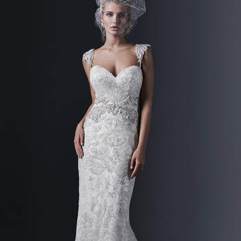 "Elegant tulle and lace combine to create this stunning sheath wedding dress, accented with a Swarovksi crystal motif at the waist. Finished with dramatic sweetheart neckline and covered buttons over zipper and inner elastic closure. Beaded embroidered, cap-sleeve shoulder straps offered separately.   <a href=""http://www.sotteroandmidgley.com/dress.aspx?style=5SS635"" target=""_blank"">Sottero &amp; Midgley</a>"