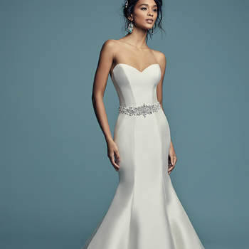 "<a href=""https://www.maggiesottero.com/maggie-sottero/cassidy/11460"">Maggie Sottero</a>  Simple yet glamorous, this Felicity Mikado wedding dress features a strapless sweetheart neckline and crystal buttons trailing from back neckline to hem. Lined with shapewear for a figure-flattering fit. Finished with zipper closure. Illusion off-the-shoulder jacket accented in vintage-inspired beading and Swarovski crystals sold separately. Beaded belt accented in Swarovski crystals sold separately."