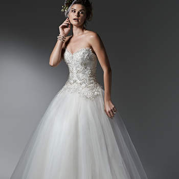 Layers of lightweight tulle create the gorgeous skirt of this whimsical ball gown, featuring a lace and Swarovski crystal studded bodice. Finished with sweetheart neckline and pearl buttons over zipper closure. <img height='0' width='0' alt='' src='http://ads.zankyou.com/mn8v' />