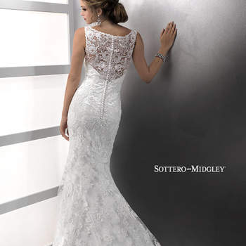 "Elegantly sophisticated, the delicate scoop illusion neckline of this romantic sheath renders this gown unforgettable. Hand beaded lace motifs dance across tulle over Demir Stretch Satin all the way to the hemline, while covered buttons add the perfect finish to the zipper back closure.  <a href=""http://www.sotteroandmidgley.com/dress.aspx?style=72403"" target=""_blank"">Sottero &amp; Midgley Platinum 2015</a>"