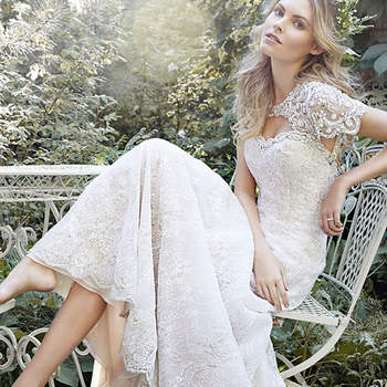 "For the princess bride seeking a slim silhouette, this exquisite lace A-line gown features a jeweled neckline and detachable keyhole coverlet artfully adorned with scalloping beaded patterns and Swarovski crystals. Finished with covered button over zipper back closure.    <a href=""http://www.maggiesottero.com/dress.aspx?style=5HS159"" target=""_blank"">Maggie Sottero Spring 2015</a>"