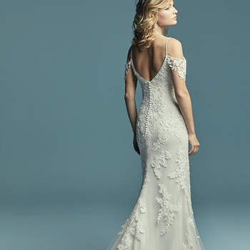 "<a href=""https://www.maggiesottero.com/maggie-sottero/angelica/1144"">Maggie Sottero</a>  Soft and elegant, this sheath wedding dress features cascading lace motifs over tulle. Illusion cold-shoulder sleeves and beaded spaghetti straps complete the sweetheart neckline and scoop back for a romantic feel. Finished with covered buttons over zipper and inner elastic closure"