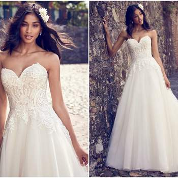 "This sweet and simple wedding dress features a bodice of lace motifs atop a tulle skirt. Complete with strapless sweetheart neckline and lined with shapewear for a figure-flattering fit. Finished with covered buttons over zipper closure.  <a href=""https://www.maggiesottero.com/maggie-sottero/rayna/11187?utm_source=zankyou&amp;utm_medium=gowngallery"" target=""_blank"">Maggie Sottero</a>"