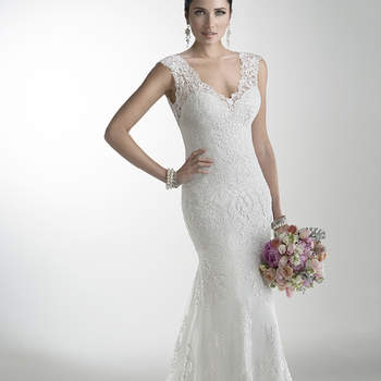 "Delicate corded lace on tulle skims the shoulders and neckline of this lightweight gown while buttons trail a zipper closure accenting an illusion back. Offered with Monroe slip dress or slip dress with raised back, and in a long-sleeve version. <a href=""http://www.maggiesottero.com/dress.aspx?style=4MS061"" target=""_blank"">Maggie Sottero</a>"