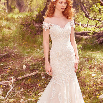 "This romantic fit-and-flare features cascades of lace appliqués that trim the illusion sweetheart neckline, illusion off-the-shoulder sleeves, and illusion low back with keyhole opening. Complete with exquisite hemline of lace appliqués. Finished with covered buttons over zipper closure.  <a href=""https://www.maggiesottero.com/maggie-sottero/marcy/10122?utm_source=mywedding.com&amp;utm_campaign=spring17&amp;utm_medium=gallery"" target=""_blank"">Maggie Sottero</a>"