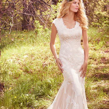 "This modest fit-and-flare features cascades of lace appliqués atop tulle and a layer of Demir satin, regal cap-sleeves, a jewel neckline, and exquisite lace hem. Finished with covered buttons over zipper and inner elastic closure.  <a href=""https://www.maggiesottero.com/maggie-sottero/elsa/10159?utm_source=mywedding.com&amp;utm_campaign=spring17&amp;utm_medium=gallery"" target=""_blank"">Maggie Sottero</a>"