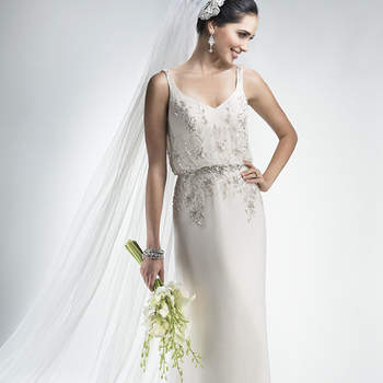 "Lightweight flowing Santorini chiffon sheath with enchanting blouson bodice, accented with twinkling Swarovski crystal embellishments and waistband. Finished with zipper over inner elastic closure.  <a href=""http://www.maggiesottero.com/dress.aspx?style=4MW005"" target=""_blank"">Maggie Sottero Platinum 2015</a>"