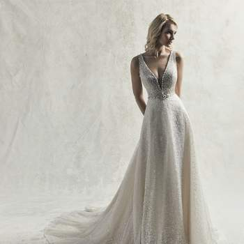 This vintage-meets-modern A-line wedding dress features allover layers of textured and sequin tulle.