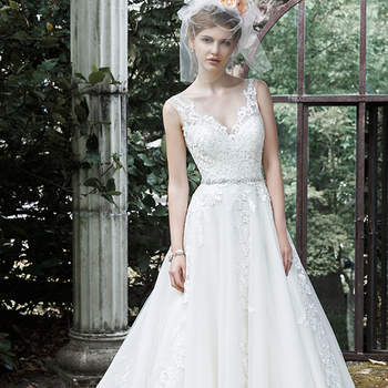 "This exquisite ball gown wedding dress is complete with floral lace appliqués drifting down a tulle skirt, an elegant illusion V-neckline, and a glittering Swarovski crystal belt. Finished with plunging V-back and crystal buttons over zipper closure. <a href=""http://www.maggiesottero.com/dress.aspx?style=5MS701"" target=""_blank"">Maggie Sottero</a>"
