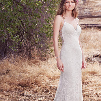 Featuring vintage-inspired allover lace atop Viva Jersey, this stunning sheath evokes unique elegance. Beaded straps glide from the V-neck to keyhole back, trimmed in illusion and crystal detail. Finished with crystal buttons and zipper closure.