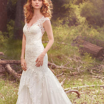 "A three-tiered skirt hemmed in scalloped lace appliqués adds romance and whimsy to this classic fit-and-flare. Lace motifs adorn the bodice, illusion V-neckline, illusion straps, and illusion open-back. Finished with covered buttons over zipper closure.  <a href=""https://www.maggiesottero.com/maggie-sottero/zalia/10155?utm_source=mywedding.com&amp;utm_campaign=spring17&amp;utm_medium=gallery"" target=""_blank"">Maggie Sottero</a>"