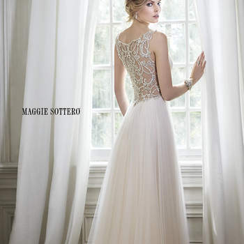 "Romance is found in this stunning tulle sheath dress with plunging neckline and sparkling Swarovski crystal embellishment at the waist. Intricate patterns of beaded embroidery adorns a daring illusion back. Finished with crystal button over zipper closure.   <a href=""http://www.maggiesottero.com/dress.aspx?style=5MR054"" target=""_blank"">Maggie Sottero Spring 2015</a>"