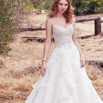 This gorgeous ballgown features an embroidered lace bodice adorned in beading and Swarovski crystals, complete with beaded spaghetti straps, scoop neck, and illusion V-back. Asymmetrical tiers of Celia Organza in the skirt complete this unique look. Finished with crystal buttons over zipper closure.