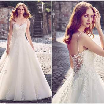 "This princess wedding gown features cascades of beaded lace motifs over layers of tulle, completing the illusion sweetheart neckline and illusion scoop back. Swarovski crystal embellishments and beaded spaghetti straps complete this elegant ballgown. Finished with crystal buttons over zipper closure.   <a href=""https://www.maggiesottero.com/maggie-sottero/amara/11152?utm_source=zankyou&amp;utm_medium=gowngallery"" target=""_blank"">Maggie Sottero</a>"