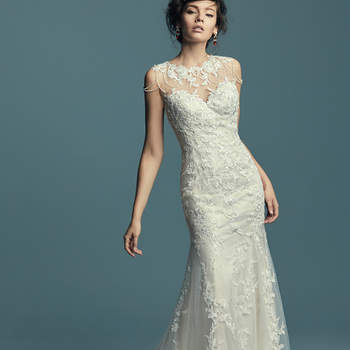 "<a href=""https://www.maggiesottero.com/maggie-sottero/dorinda/11438"">Maggie Sottero</a>  This vintage-inspired wedding dress features a unique neckline of beaded lines and lace motifs along the illusion jewel neckline and illusion back. Soft fit-and-flare silhouette features embroidered lace motifs atop tulle. Finished with covered buttons over zipper closure."