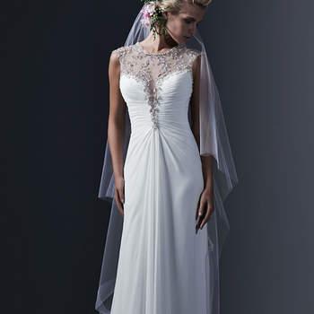 """Les cristaux de Swarovski et les perles donnent à ce décolleté illusion  une élégance hors normes à cette robe de mariée fourreau disponible à Paris en mousseline mousseline ou en tulle. Le dos est lui aussi incrusté de cristaux. On note la boutinnière constituée de boutons en cristaux.    <a href=""""http://www.sotteroandmidgley.com/dress.aspx?style=5SR683"""" target=""""_blank"""">Sottero &amp; Midgley</a>"""