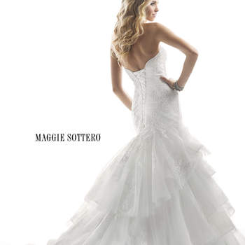 "Unforgettable is this corded embroidered and Chantilly lace on tulle over Chic Organza gown, with a form fitting ruched bodice and cascading layered skirt. Finished with sparkling Swarovski crystal accents and corset back closure.   <a href=""http://www.maggiesottero.com/dress.aspx?style=4MS855"" target=""_blank"">Maggie Sottero Platinum 2015</a>"