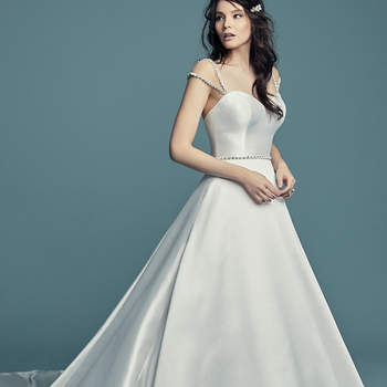"<a href=""https://www.maggiesottero.com/maggie-sottero/benicia/11456 5"">Maggie Sottero</a>  This Keela Mikado wedding dress features a strapless sweetheart neckline and graceful ballgown skirt. Swarovski crystals accent the line of covered buttons along the train. Finished with crystal buttons over zipper and inner elastic closure. Beaded belt accented in Swarovski crystals sold separately. Illusion cap-sleeves trimmed in Swarovski crystals sold separately. <a>Maggie Sottero</a>"