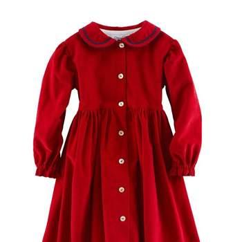 Sencillo vestido rojo para las invitadas más peques. Foto: Óscar de la Renta