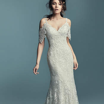 "<a href=""https://www.maggiesottero.com/maggie-sottero/elliana/11445"">Maggie Sottero</a>  Chic and romantic, this soft sheath features variations of embroidered lace motifs and soft lace over dotted tulle. Cold-shoulder sleeves comprised of sheer lace, completing the sweetheart neckline and illusion scoop back. Finished with crystal buttons over zipper closure."