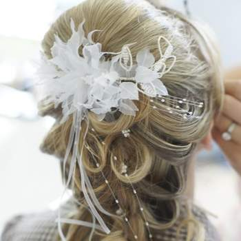 Pinned curls with floral hairpiece