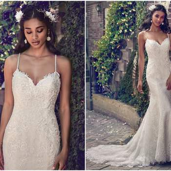 "This wedding dress features embroidered lace motifs along the sweetheart neckline, illusion scoop back, and bodice, flowing into an allover lace bodice and skirt. Delicate beaded spaghetti straps complete the chic romance of this sheath gown. Finished with crystal buttons over zipper closure.   <a href=""https://www.maggiesottero.com/maggie-sottero/teresa/11195?utm_source=zankyou&amp;utm_medium=gowngallery"" target=""_blank"">Maggie Sottero</a>"