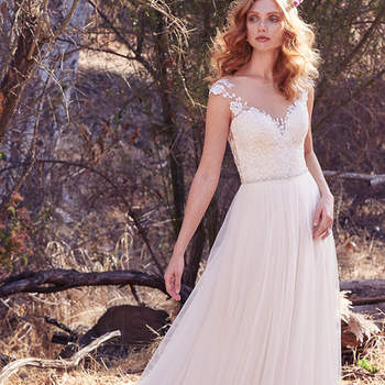 Delicate lace appliqués float over the bodice, plunging sweetheart neckline, and illusion cap-sleeves in this ethereal A-line. A dazzling bead and Swarovski crystal belt and illusion open back trimmed with lace appliqués evoke subtle glamour. Finished with covered buttons and zipper closure.