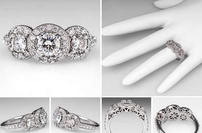 Anello di fidanzamento vintage (ca. 1960) con trilogy di diamanti in taglio brillante, circondati da pavé di brillanti. Foto Eragem