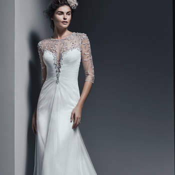 "Simply elegant, this flowing sheath wedding dress, available in Paris chiffon or tulle, is accented with demure illusion beading, twinkling with Swarovski crystals and draping the neck, three-quarter sleeves and daring back. Finished with crystal buttons over zipper closure.   <a href=""http://www.sotteroandmidgley.com/dress.aspx?style=5SR684MC"" target=""_blank"">Sottero &amp; Midgley</a>"