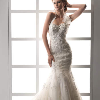 """Erhalten auch Sie diese verführerische Silhouette mit dem Meerjungfrauen-Schnitt. Florale Spitze sorgt für die Romantik. <a href=""""http://www.sotteroandmidgley.com/dress.aspx?style=JSM1428"""" target=""""_blank"""">Sottero and Midgley</a>"""