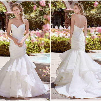 Auch hier verleibt die asymmetrische Note dem Kleid etwas besonderes ein. Besonders der leicht spitz zulaufende Herzausschnitt ist sehr gelungen.