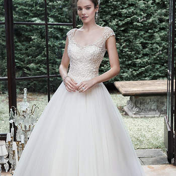 "A lavish bead embroidered bodice, adorned with sparkling Swarovski crystals and sequins, finds balance with this unembellished tulle skirt, striking the quintessential modern romantic ball gown wedding dress, accented with illusion cap-sleeves, and scoop neckline and back. Finished with covered buttons over zipper closure.  <a href=""http://www.maggiesottero.com/dress.aspx?style=5MB713"" target=""_blank"">Maggie Sottero</a>"