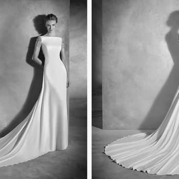 Asombroso vestido de talle bajo, escote barco y favorecedora silueta sirena que enmarca las curvas femeninas. Un modelo de crepe con un precioso mosaico de pedrería en las mangas y en la espalda.