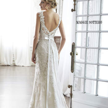 "The pinnacle of romance is found in this streamlined sheath rendered in exquisite lace. Complete with dramatic V-back beautifully detailed with illusion lace, sweetheart neckline and delicate cap-sleeves. Finished with covered button over zipper and inner elastic closure and optional grosgrain ribbon belt with beaded motif.   <a href=""http://www.maggiesottero.com/dress.aspx?style=5MN083"" target=""_blank"">Maggie Sottero Spring 2015</a>"